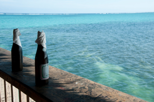 Two local beers on ledge at a bar, San Pedro, Ambergris Caye, Corozal District, Belize